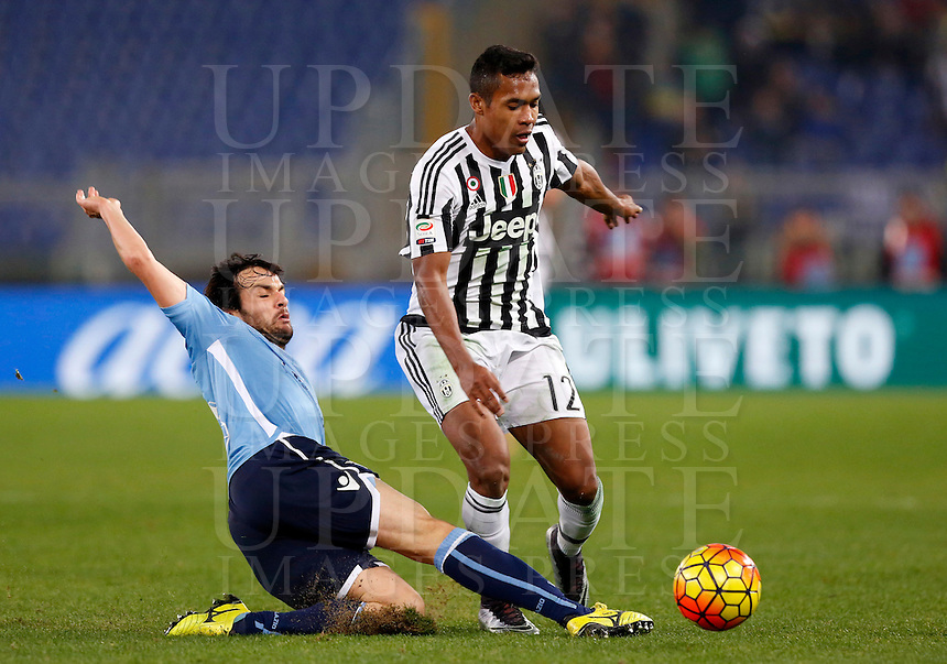 Calcio, Serie A: Lazio vs Juventus. Roma, stadio Olimpico, 4 dicembre 2015.<br /> Juventus' Alex Sandro, right, is tackled by Lazio's Marco Parolo during the Italian Serie A football match between Lazio and Juventus at Rome's Olympic stadium, 4 December 2015.<br /> UPDATE IMAGES PRESS/Riccardo De Luca