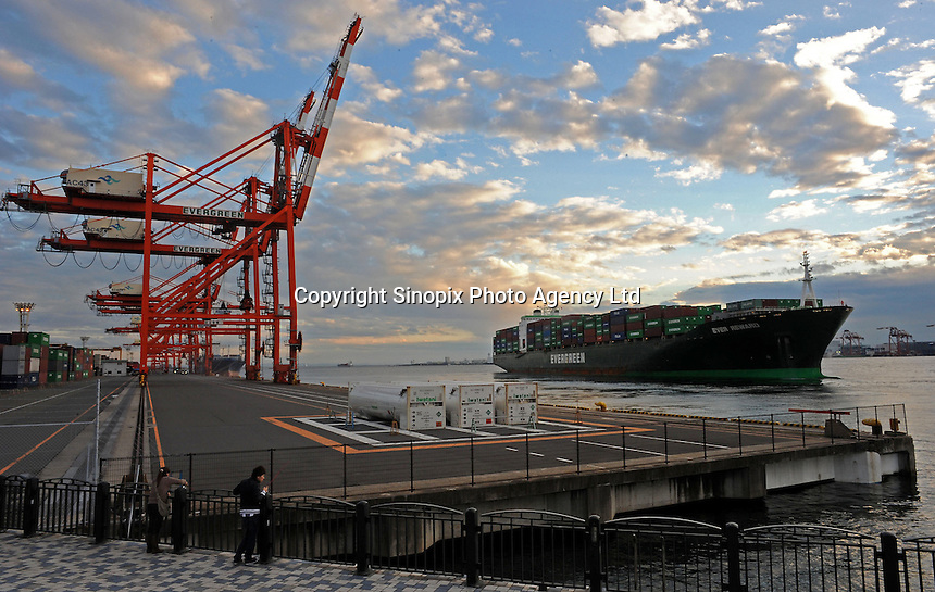 An Evergreen ship the Ever Reward leaves dock at Tokyo Bay Dockyard on Odaiba Island, Tokyo, Japan. Japan has seen a decrease in exports due to the value of the Yen which has made imported goods much cheaper in the recession hit country, the world's third largest economy..23 Nov 2010