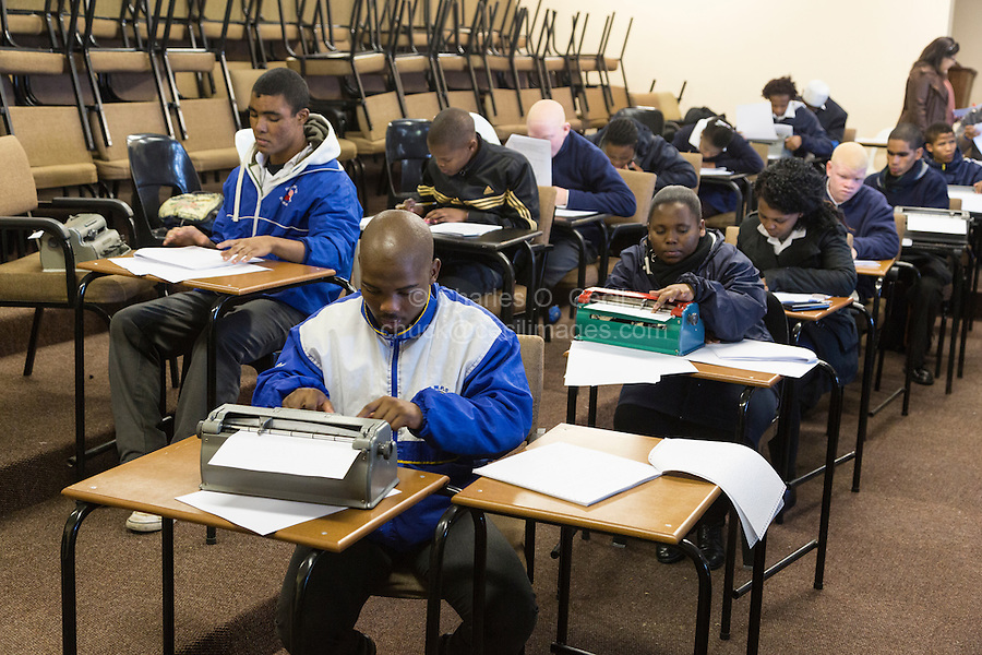 South Africa, Cape Town.  Blind Students Typing on Perkins Brailler or Reading Braille with Fingertips.  Athlone School for the Blind.