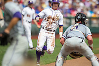 LSU Tigers second baseman Jared Foster (17) sprints towards home as TCU Horned Frogs catcher Evan Skoug (9) blocks the plate during the NCAA College World Series on June 14, 2015 at TD Ameritrade Park in Omaha, Nebraska. TCU defeated LSU 10-3. (Andrew Woolley/Four Seam Images)