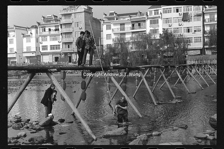 Xiashan Village, Kaihua County, Quzhou City, Zhejiang Province - Villagers use harpoon to harvest fish, December 2020. Xiashan Village is located along the Qiantang River.