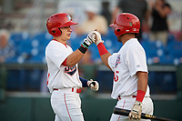 Auburn Doubledays right fielder Jacob Rhinesmith (18) is congratulated by Wilmer Perez (45) after hitting a home run in the bottom of the first inning during a game against the Hudson Valley Renegades on September 5, 2018 at Falcon Park in Auburn, New York.  Hudson Valley defeated Auburn 11-5.  (Mike Janes/Four Seam Images)