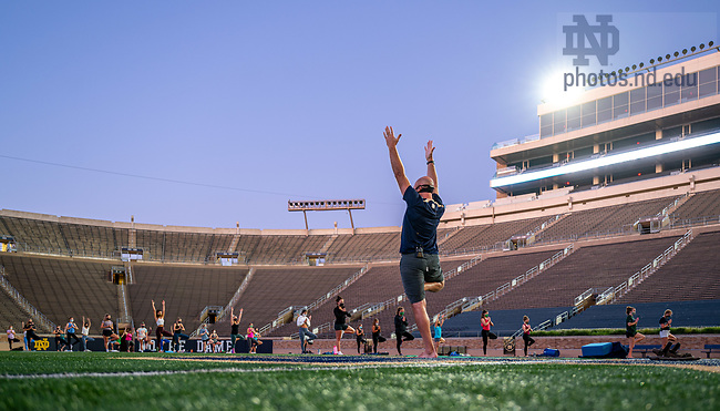 September 3, 2020; Notre Dame RecSports Yoga instructor Steve Krojniewski (aka: 'Yoga Steve') leads participants in masked and socially-distanced Yoga in Notre Dame Stadium. (Photo by Matt Cashore/University of Notre Dame)