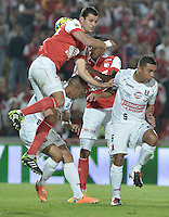 BOGOTÁ -COLOMBIA, 04-05-2014. Jose J de la Cuesta (Izq) y Wilder Medina (C)  de Independiente Santa Fe disputan el balón con Camilo Perez (Der) del Once Caldas durante partido de vuelta por los cuartos de final de la Liga Postobón  I 2014 jugado en el estadio Nemesio Camacho el Campín de la ciudad de Bogotá./ Independiente Santa Fe player Jose J de la Cuesta (L) and Wilder Medina (C) fight for the ball with Once Caldas player Camilo Perez (R) during second leg match for the quarterfinals of the Postobon League I 2014 played at Nemesio Camacho El Campin stadium in Bogotá city. Photo: VizzorImage/ Gabriel Aponte / Staff