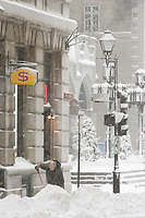 Montreal (Qc) CANADA - December 3rd 2007-.A man shovel snow on the sidewalk near Notre-Dame Basilica while.Heavy snow fall on Montreal, more than 30cm is expected...photo : (c) ROUSSEL - Images Distribution.