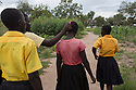 Uganda - Palorinya Refugee Camp - A group of South Sudanese orphans walk to school together. <br /> Since the start of the war dozens of thousands of children have fled South Sudan without their parents. <br /> Food insecurity and lack of education are the two primary reasons of this emergency. The war has forced the majority of schools to shut down, prompting children to flee to Uganda in order to continue their studies.