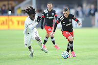 WASHINTON, DC - FEBRUARY 29: Washington, D.C. - February 29, 2020: Joseph Mora #28 of D.C. United battles the ball with Lalas Abubakar #6 of the Colorado Rapids. The Colorado Rapids defeated D.C. United 2-1 during their Major League Soccer (MLS)  match at Audi Field during a game between Colorado Rapids and D.C. United at Audi FIeld on February 29, 2020 in Washinton, DC.