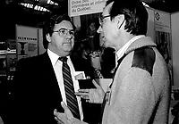 February 9, 1985 - File Photo - Yvon Picotte (L) and Robert Bourassa, attend the Salon de la jeunesse (youth fair) at the Velodrome. -