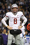 """Marshall Lobbestael (#8), Washington State quarterback, waits for the play call from the sidelines during the Cougars Pac-10 conference """"Apple Cup"""" showdown with arch-rival Washington at Husky Stadium in Seattle, Washington, on November 28, 2009.  The Cougars lost to the Huskies in the game, 30-0."""