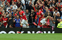 Pictured: Wayne Rooney (L) of Manchester United celebrating his equaliser making the score 1-1. Saturday 16 August 2014<br />