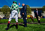 LEXINGTON, KENTUCKY - APRIL 07: A horse is walked in the paddock before an undercard race as its jockey looks on, on opening day at Keeneland Race Course on April 7, 2017 in Lexington, Kentucky. (Photo by Scott Serio/Eclipse Sportswire/Getty Images)