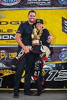 Jul 22, 2018; Morrison, CO, USA; NHRA top fuel driver Leah Pritchett celebrates with husband Gary Pritchett after winning the Mile High Nationals at Bandimere Speedway. Mandatory Credit: Mark J. Rebilas-USA TODAY Sports