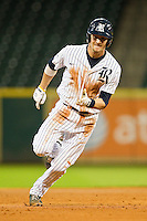 Geoff Perrott #28 of the Rice Owls hustles towards third base against the Texas Tech Red Raiders at Minute Maid Park on March 3, 2012 in Houston, Texas.  The Owls defeated the Red Raiders 6-2.  Brian Westerholt / Four Seam Images