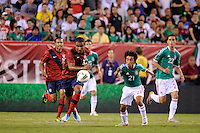 Juan Agudelo (18) of the United States and Christian Bermudez (21) of Mexico. The men's national teams of the United States (USA) and Mexico (MEX) played to a 1-1 tie during an international friendly at Lincoln Financial Field in Philadelphia, PA, on August 10, 2011.