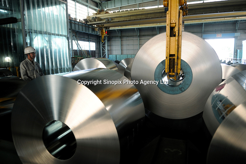 Steel plate rolls at Shanghai Baosteel factory. Baosteel is the largest Chinese iron and steel conglomerate. It is a state-owned enterprise, headquartered in Shanghai..