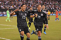 EAST RUTHERFORD, NJ - SEPTEMBER 7: Erick Gutierrez #25 of Mexico celebrates his score with Javier Hernandez #14 of Mexico during a game between Mexico and USMNT at MetLife Stadium on September 6, 2019 in East Rutherford, New Jersey.