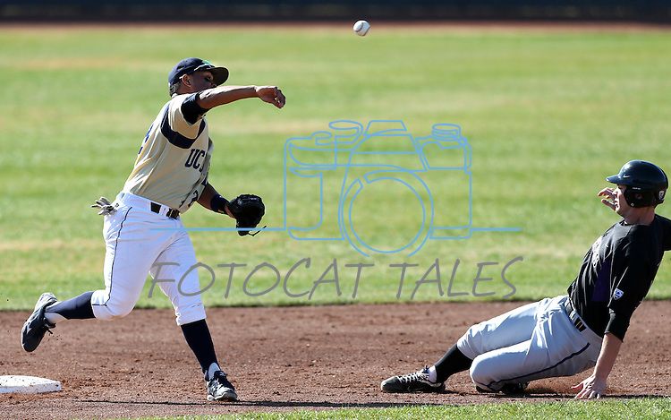 UC Davis' Steven Patterson tries to turn a double play against the Huskies in a college baseball game between the Washington Huskies and the UC Davis Aggies in Davis, Ca., on Sunday, Feb. 17, 2013. Davis won 7-5 to finish their season opening series 3-1. .Photo by Cathleen Allison