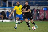 22nd July 2021; Stadium Yokohama, Yokohama, Japan; Tokyo 2020 Olympic Games, Brazil versus Germany; Matheus Cunha of Brazil and Anton Stach of Germany challenge for a loose ball