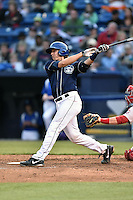 Asheville Tourists catcher Robbie Perkins (5) swings at a pitch during game one of a double header against the Greenville Drive on April 18, 2015 in Asheville, North Carolina. The Tourists defeated the Drive 2-1. (Tony Farlow/Four Seam Images)