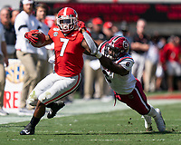ATHENS, GA - OCTOBER 12: D'Andre Swift #7 of the Georgia Bulldogs is tackled by T.J. Brunson #6 of the South Carolina Gamecocks during a game between University of South Carolina Gamecocks and University of Georgia Bulldogs at Sanford Stadium on October 12, 2019 in Athens, Georgia.