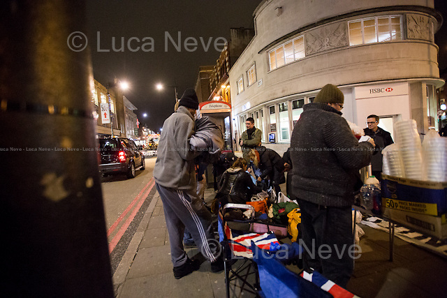 """London, 16/12/2015. This evening, members of the public lead by """"Street Kitchens"""" - a non-profit organisation that provides information and help for homeless people - met outside Camden Town Station for """"distributing and collecting essential items to those who may need them on our streets"""". Around 8:30PM, a small group of people moved towards King's Cross and Euston stations trying to help homeless people outside two of the major London's train stations. Wool hats, gloves, jumpers, trousers, shoes, tooth paste and brushes, coats, and then cups of tea and hot soups, sandwiches, water, bowls of rise, biscuits and a lot of company and smiles were donated this evening to the homeless people who are facing the London's cold winter. <br /> <br /> For more information please click here: http://www.streetskitchen.co.uk & http://on.fb.me/1T3sCCt & http://on.fb.me/1YmT4bE & http://on.fb.me/1YmT8Iu <br /> <br /> 'Thoughts of Christmas': A Song to raise awareness and benefit our Streets - Please click here: http://bit.ly/21QkVWj<br /> <br /> EDIT - 11 APRIL 2016 - Following my return from Calais and Dunkirk camps in April 2016, news came to light of an ongoing court case that one of the people featured in these photo stories is involved in as a defendant. I had not known about this previously, and neither had Zekra, who is the organiser of """"Happy Ravers"""" - one of the groups featured in these photostories. <br /> These photostories do show great work being done to help homeless people, and I will continue documenting this project. Though it is the job of the courts to reach a verdict (I do believe people are innocent until proven guilty), I have none the less decided that moving forward I will focus only on Zekra's work."""