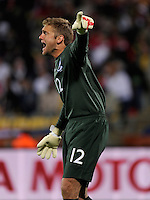 England goalkeeper Robert Green calls out to his teammates. USA vs England in the 2010 FIFA World Cup at Royal Bafokeng Stadium in Rustenburg, South Africa on June 12, 2010.