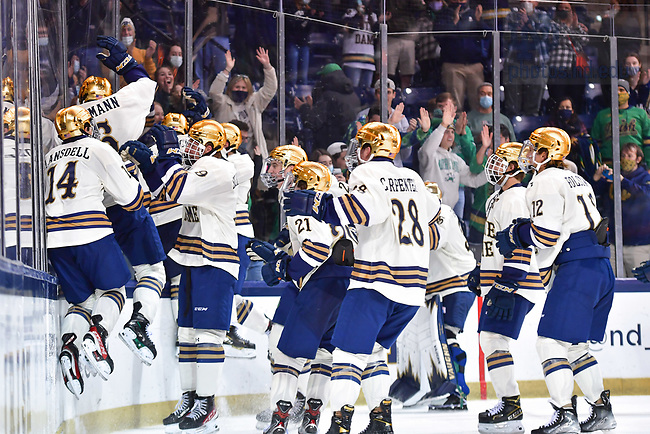 October 22, 2021; Hockey players celebrate a win over RIT by jumping into the glass in front of the student section at the Compton Family Ice Arena. (photo by Matt Cashore/University of Notre Dame)