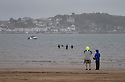 24/05/15<br /> <br /> A group of wet-suit-wearing swimmers brave the rain to swim off Instow beach, North Devon as the bank holiday weekend weather takes a turn for the worse.<br /> <br /> All Rights Reserved - F Stop Press.  www.fstoppress.com. Tel: +44 (0)1335 418629 +44(0)7765 242650