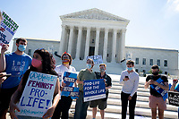 A Pro-Life activist holds a 22 week fetal model during a rally outside the United States Supreme Court in Washington D.C., U.S., on Monday, June 29, 2020.  The Court delivered a 5-4 ruling blocking a restrictive abortion law in Louisiana Monday morning. Photo Credit: Stefani Reynolds/CNP/AdMedia