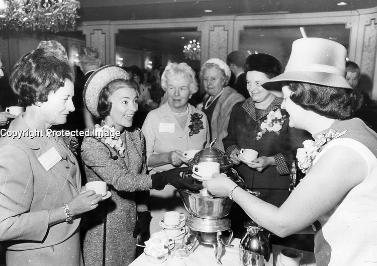 A very Conservative tea. It's tea time for Mrs. Duff Roblin, wife of the former premier of Manitoba. The reception was given for her Saturday by the wives of the provincial cabinet ministers of Metro Toronto. Left to right: Mrs. Stanley Randall, Mrs. Roblin, Mrs. Leslie Rowntree, Mrs. John Robarts and Mrs. Bobbie Park is serving.<br /> <br /> Photo : Boris Spremo - Toronto Star archives - AQP