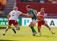 24th April 2021; Brentford Community Stadium, London, England; Gallagher Premiership Rugby, London Irish versus Harlequins; Paddy Jackson of London Irish is tackled by Tom Lawday of Harlequins