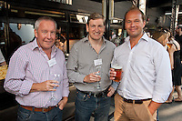 Keeping an eye on the burgers are Paul Tewson and Chris Hall of Gilbert & Hall Developments and James Firth of JMF Architects