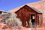 """Abandoned cabin on """"Bachelor's Row"""", Bannack, Montana, a ghost town preserved as a Montana State Park. Camping is peaceful, the town historic.  A remnant of Montana's gold mining history the park is west of Dillon, Montana a few miles off State Highway 278.  Masonic Lodge was upstairs."""