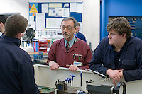 Engineering apprentices and teaching staff at Kingston College..