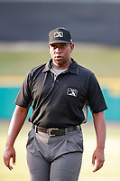 First base umpire Dexter Kelley heads to his position during the game between the Mississippi Braves and the Tennessee Smokies at Smokies Stadium on July 16, 2021, in Kodak, Tennessee. (Danny Parker/Four Seam Images)