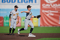West Virginia Black Bears shortstop Ethan Paul (62) throws to first base as second baseman Cory Wood (27) looks on during a NY-Penn League game against the Auburn Doubledays on August 23, 2019 at Falcon Park in Auburn, New York.  West Virginia defeated Auburn 8-1, the first game of a doubleheader.  (Mike Janes/Four Seam Images)