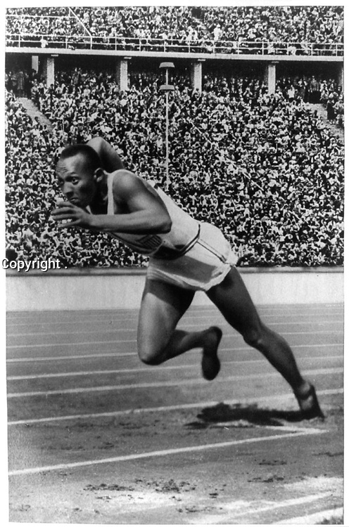 """""""Jesse Owens at start of record breaking 200 meter race.""""<br /> <br /> This record contains unverified, old data from caption card.<br /> Olympic Games (11th : 1936 : Berlin, Germany)"""