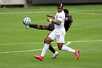 LOS ANGELES, CA - OCTOBER 25: Jesus David Murillo #94 of LAFC clears a ball during a game between Los Angeles Galaxy and Los Angeles FC at Banc of California Stadium on October 25, 2020 in Los Angeles, California.