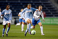 Chicago Red Stars midfielder Chioma Igwe (12) controls the ball.  The Chicago Red Stars defeated the Boston Breakers 4-0 at Toyota Park in Bridgeview, IL on April 25, 2009.