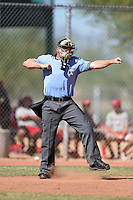 Umpire Jake Wilburn during an Instructional League game between the Kansas City Royals and Cincinnati Reds on October 16, 2014 at Goodyear Training Facility in Goodyear, Arizona.  (Mike Janes/Four Seam Images)