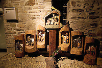 """Switzerland. Canton Tessin. Vira Gambarogno. The old town shows an exhibit of various Nativity scenes, illuminated at night for the Christmas holiday season. A Nativity Scene, may be used to describe any depiction of the Nativity of Jesus in art, but in the sense covered here, also called a crib or in North America and France a crèche (meaning """"crib"""" or """"manger"""" in French). It means a three-dimensional folk art depiction of the birth or birthplace of Jesus, either sculpted or using two-dimensional (cut-out) figures arranged in a three-dimensional setting. Christian nativity scenes, in two dimensions (drawings, paintings, icons, etc.) or three (sculpture or other three-dimensional crafts), usually show Jesus in a manger, Joseph and Mary in a barn (or cave) intended to accommodate farm animals. The scene includes the Magi or Three Wise Men (with or without a camel), shepherds and sheeps. Mailbox. © 2007 Didier Ruef"""