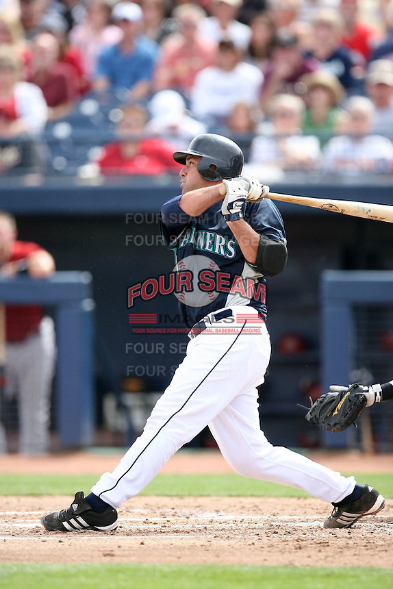 March 8, 2009: Jamie Burke (15) of the Seattle Mariners at Peoria Sports Complex in Peoria, AZ.  Photo by: Chris Proctor/Four Seam Images