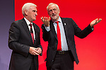 © Joel Goodman - 07973 332324 . 26/09/2016 . Liverpool , UK . Shadow chancellor JOHN MCDONNELL and party leader JEREMY CORBYN after McDonnell delivers his speech on the economy to the conference . The second day of the Labour Party Conference at the ACC Liverpool . Photo credit : Joel Goodman
