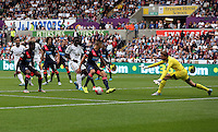 Pictured: Bafetimbi Gomis of Swansea takes a shot, Tim Krul of Newcastle saves the ball Saturday 15 August 2015<br /> Re: Premier League, Swansea City v Newcastle United at the Liberty Stadium, Swansea, UK.