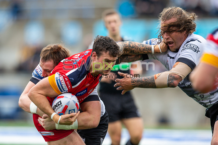 Picture by Kevin Sousa/SWpix.com - 07/10/2018 - Rugby League - Betfred Super League - The Qualifiers - Million Pound Game - Toronto Wolfpack v London Broncos - Lamport Stadium, Toronto, Canada - Jay Pitts of the London Broncos is stopped by Ashton Sims #10 of the Toronto Wolfpack.