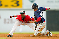 Shortstop Jurickson Profar #10 of the Hickory Crawdads puts the tag on Henry Ramos #25 of the Greenville Drive at L.P. Frans Stadium on September 3, 2011 in Hickory, North Carolina.  The Crawdads defeated the Drive 3-0.  (Brian Westerholt / Four Seam Images)