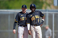 Iowa Hawkeyes head coach Rick Heller (21) and right fielder Devin Pickett (7) during a game against the Dartmouth Big Green on February 27, 2016 at South Charlotte Regional Park in Punta Gorda, Florida.  Iowa defeated Dartmouth 4-1.  (Mike Janes/Four Seam Images)