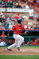 Erie SeaWolves second baseman Kody Eaves (22) follows through on a swing during a game against the Hartford Yard Goats on August 6, 2017 at UPMC Park in Erie, Pennsylvania.  Erie defeated Hartford 9-5.  (Mike Janes/Four Seam Images)