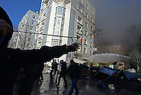 A protester uses a slingshot in Maidan square. Kiev, Ukraine