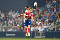 KANSAS CITY, KS - JULY 31: Paxton Pomykal #19 FC Dallas goes up for  a header with Luis Martins #36 Sporting KC during a game between FC Dallas and Sporting Kansas City at Children's Mercy Park on July 31, 2021 in Kansas City, Kansas.